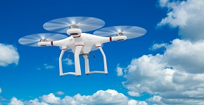 Image of a drone against scenic view of blue sky